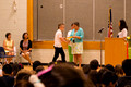 Receiving his 6th grade graduation certificate