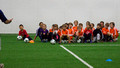 Soccer practice - paying attention to the coach