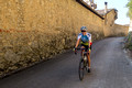 Karen sporting her new Italian jersey riding by the monastery