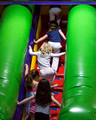 Climbing the big slide at Bouncetown